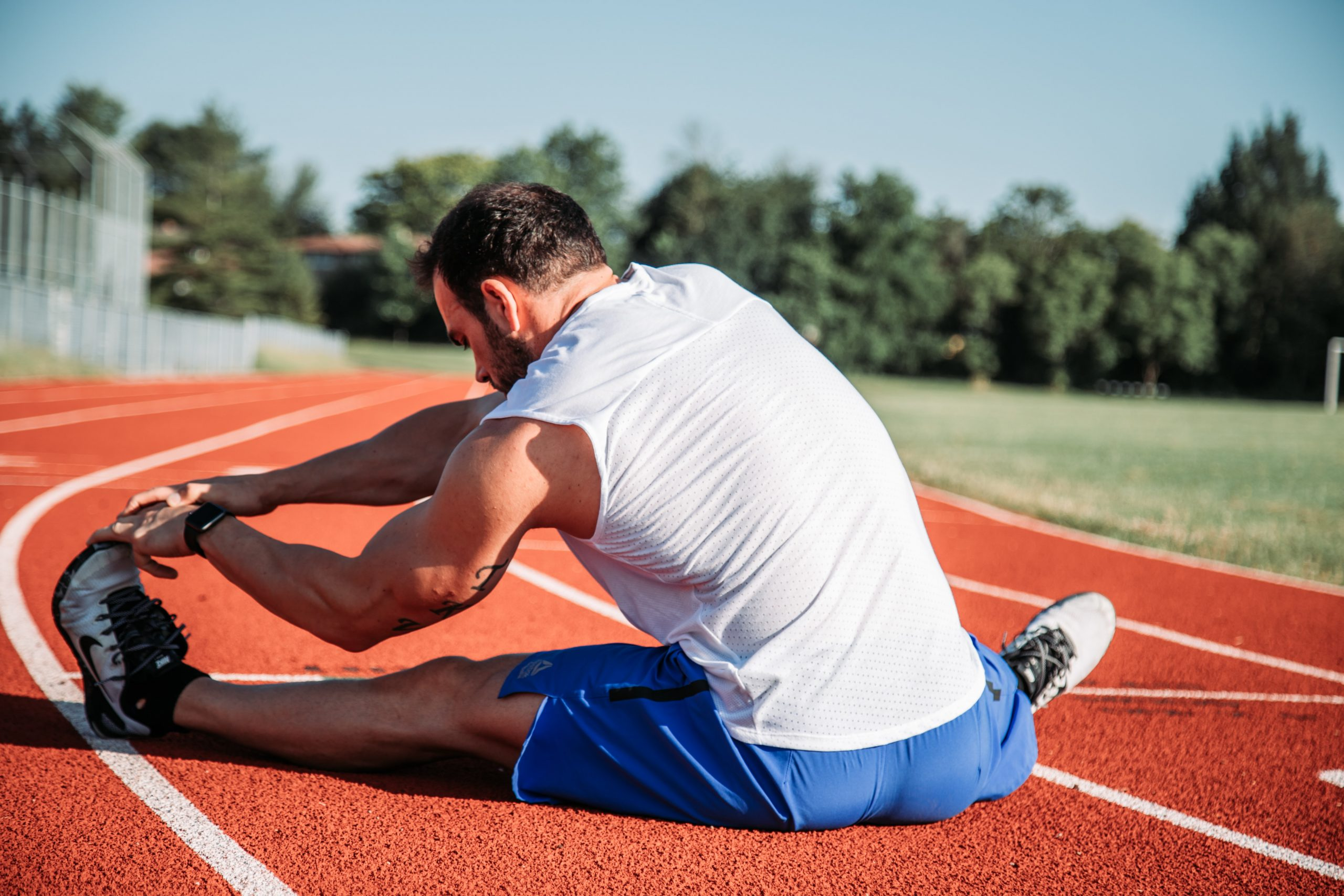 Guy stretching before sprint